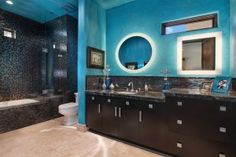 Turquoise is the color! Mix that beautiful color with great wall finishes, tiles, and accents, then custom back lit vanity mirrors and this is what you achieve...perfection.