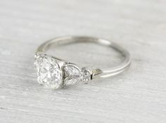 Elegant vintage platinum engagement ring centered with an approximate 1.01 carat EGL certified old European cut diamond with I-J color and VS2 clarity. Circa 1920 Center diamond is set in a classic Deco four prong setting accented by single cut diamonds on each shoulder and the faintest millegrain edges. Elegant simple band. Ring sits very low on the finger.Learn more about Art Deco rings Diamond and gold mining has caused devastation in areassuch as Africa, wreaking havoc on delicate…