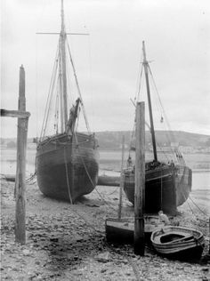 A sloop and a schooner beached at Appledore, Devon, a typical coasters West Country harbour. Devon And Cornwall, Sailing Ships, Infographics, Britain, Coasters, Cottage, Boat, Black And White, Country