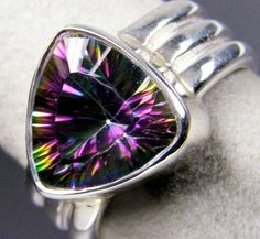 """MODERN MYSTIC GEMSTONE SILVER RING SIZE 9.5 GTJA672    A new high tech enhancement process applied to colorless stones such as quartz and topaz produces an exciting new variety known as """"Mystic Quartz"""".  Mystic quartz shows a stunning rainbow effect and very popular with jewellers as they can make exotic  design jewellery. This ring is just beautiful."""