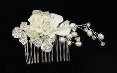 Bridal Handmade Swarovski Crystal With Pearl and Silk Flower Hair comb For Wedding 60274 21 Bridal Accessories http://www.amazon.com/dp/B005516A5I/ref=cm_sw_r_pi_dp_.FR9tb1400XC5