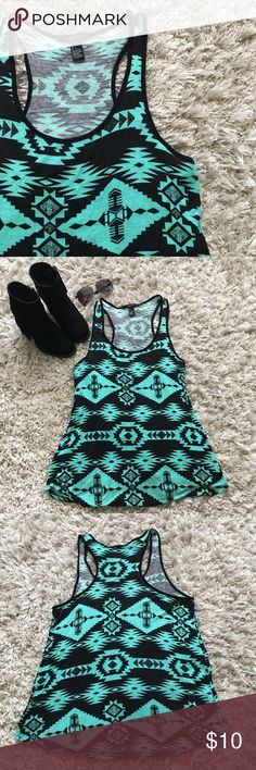 Tribal Print Tank Top A black and teal tribal print tank top with a slight relaxed fit! Only worn once, in great condition!                                                                                         NO TRADES                                                                                 All Reasonable offers Considered Forever 21 Tops Tank Tops