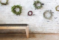 A Pierre Cronje Loft bench getting ready for the festive season with some rustic wreaths.   Photography by Henk Hattingh for Crush Magazine.