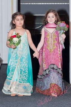 Baby girls in wedding attire from East