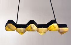 MATTHEW FAIRBANKS DESIGN - The Vega Chandelier is a modular lighting system fabricated from geometric metal components that support hand carved onyx diffusers. The exa...