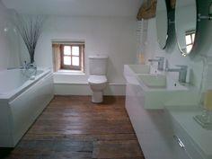 En-suite - wooden floor - white - clean lines - mirrors
