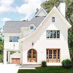Creamy white brick and wood doors!