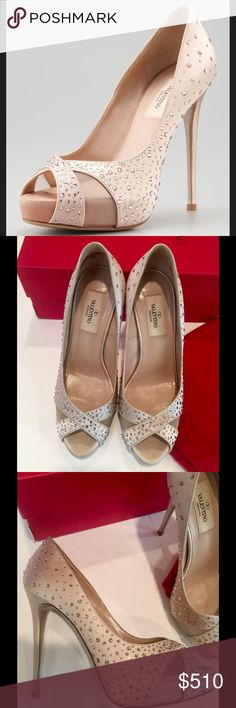 Valentino crystal covered satin pumps size 37 US 7 Valentino covers rosy satin in light-catching crystals, giving this pump a jewelry-like finish.  💯% authentic Valentino crystal covered satin pumps, size 37 (US 7).  These champagne pumps are in excellent condition, with slight wear on soles; no other flaws.  Comes with box/dust bag.  * Satin upper adorned with round-cut crystals * Crossover straps with mesh inserts at peep-toe * Low-dipped vamp elongates the leg * Leather lining, padded…