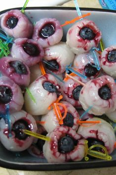 "Creepy Halloween Eyeballs | ""If you are looking for creepy Halloween food ideas, try these scary-looking eyeballs that actually taste delicious."" #halloween #halloweenrecipes #allrecipes"