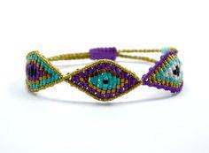 Purple and turquoise, triple eye bracelet Textile Jewelry, Macrame Jewelry, Jewelry Bracelets, Natural Stone Jewelry, Evil Eye Bracelet, Crafts For Teens, Beadwork, Friendship Bracelets, Turquoise
