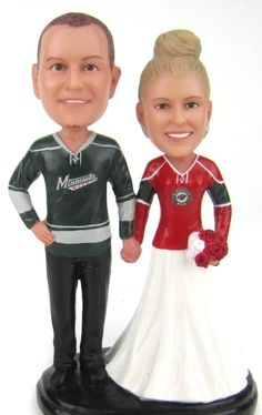 custom sculpted hockey wedding cake topper with minnesota wilds hockey jerseys is sculpted to look like