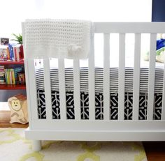 Baby Mod Olivia crib with the base painted white. DIY crib skirt. Navy and yellow nursery.