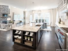 With ample counter space and an open layout, your elegant kitchen island deserves to be the center of attention. Kitchen Dining Combo, Open Kitchen And Living Room, Kitchen Family Rooms, Kitchen Design, Kitchen Island, Pulte Homes, Open Kitchen Layouts, Open Concept Kitchen, Layout Design