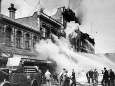 Fire at Ballantyne's department store in showing fire fighters on Colombo Street, Christchurch, with water hoses. South Pacific, Pacific Ocean, Christchurch New Zealand, State Of Arizona, Water Hose, Department Store, Photo S, Landscape Photography, Beautiful Places