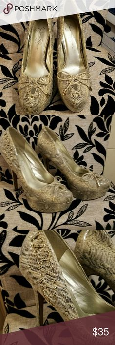 Jessica Simpson Snake Skin Print Stilettos Snake Skin Print With Tie up Bows. Great condition. Selling for my friend. Would keep these if it was my size!! Lightly scuffed on edge of heels as shown. Jessica Simpson Shoes Heels