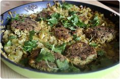 Soy patties with lots of herbs over a bed of lemony leeks