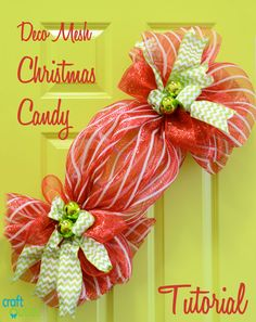 Here is a sweet holiday treat that you will not feel guilty about. This cute Christmas wreath looks like a piece of your favorite wrapped holiday candy. Created with red and white striped deco mesh and a new table work form, this Candy Wreath can be made in a less…