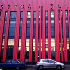 Barcode building in #saintpetersburg #russia. Each bar form a giant window on red background. by zenia.moon
