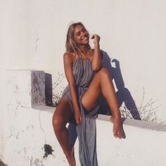 Wheretoget - Alexis Ren wearing a grey maxi dress with side splits