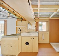The 55-square-metre space takes over a former photographer's studio that's in the same building as Aixopluc's workshop. When the photographer retired, the studio sat vacant for two years with its interiors gradually deteriorating. Concept Architecture, Interior Architecture, Shower Cubicles, Best Architects, Small Corner, Photographic Studio, Cupboard Storage, Ceiling Beams, Apartment Interior