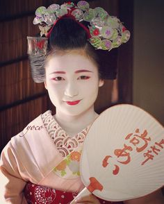 July 2016: first-year maiko Naoai with a summer fan with her name on it by  yoco405_ on Instagram