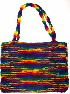 This beautiful Rainbow Tote Bag (Medium) is hand knit, with a convenient sewn in liner. Strong handles make this tote great for carrying along with you everyday. You can use it for books, magazines, yarn, or any other accessories. It is also light, and the colors go great with all kinds of fashion. Also makes a great gift idea for any age, and any occasion. Plus each one is unique all on its own and easy to care for. Get one for yourself and one for a friend! Only $29.99 each!