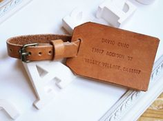 This personalized leather luggage tag would make a great gift.