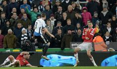 Newcastle United's Welsh defender Paul Dummett (2nd L) hits his shot which deflects off Manchester United's English defender Chris Smalling (R) for Newcastle's third goal during the English Premier League football match between Newcastle United and Manchester United at St James' Park in Newcastle-upon-Tyne, north east England on January 12, 2016. The game finished 3-3. AFP PHOTO / OLI SCARFF SCARFF