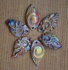 Flower using Copper Ammonite Leaves. www.etsy.com/listing/76617317/handmade-copper-ammonite-le...