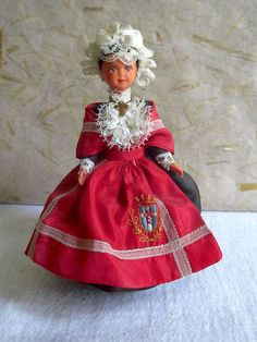 This little doll wears the costume of the town of Cholet in Anjou, an historical Province of France close to Britanny.    On her head she wears