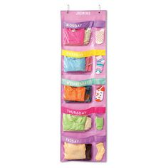 Days-Of-The-Week Hanging Organizer $24.99...could make one for each child...netting/mesh-type material for pockets to see through