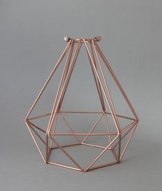 Copper is very on-trend right now and this copper cage light shade is just the item to make a statement in your home.