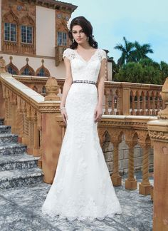 Sincerity wedding dress style 3831   Tulle, alencon lace, beaded lace fit and flare dress emphasized by a V-neck