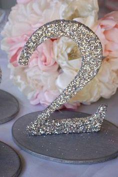 20 DIY Wedding Table Number IdeasConfetti Daydreams – Wedding Blog  Love the glitter Possible in blue gold and coral glitter?
