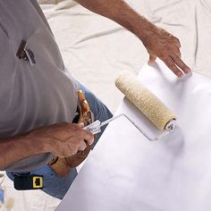 Wallpapering Tip: Don't allow paste to get on the table or it will mar the next sheet (wipe it off with a barely damp sponge if it does). Slide the wallpaper all the way to the edge of the table to apply paste to the ends and edges.