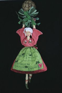 "Give Us A Kiss  This wonderful 15"" doll suspended from a grapevine ball with mistletoe combines simple shapes with lots of character. Blanket stitch detailing adorns her festive costume. A delightful project for dollmakers of all skill levels.  Patterns by Colleen Babcock"