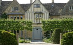 Look at those pleached crab apple trees! What an entrance! Renovated garden for a manor house in Oxfordshire - Arne Maynard Garden Design: