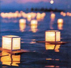 floating water lanterns for wedding lakeside