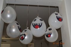super mario boo balloons, ranging from door frame or ceiling. realistic idea of mario themed decorations