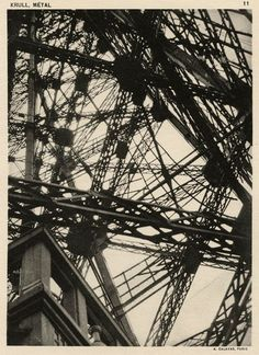 """germaine-krull-metal-calavas-concerned """"the essentially masculine subject of the industrial landscape.""""[5] Krull shot the portfolio's 64 black-and-white photographs in Paris, Marseille, and Holland. The portfolio's subjects range from bridges, buildings and ships to bicycle wheels; it can be read as either a celebration of machines or a criticism of them."""