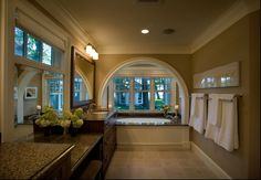 An Extraordinary Bathroom Design With Brown Color And Tile Flooring With Arched Window And Built In Bathtub With Classic Glamorous Cabinet And Fascinating Sinks Classic cottage on the beautiful shores of Lake Home design
