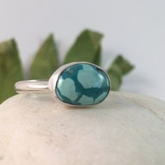 Turquoise Ring, Size 7 1/2, Sterling Silver, Oval, Teal, Light Blue  This ring features a sideways laying oval teal & light blue turquoise stone enrobed in a simple bezel. It sits atop a hand formed, single, 10-gauge sterling silver ring band. Ring details: Size- 7 1/2 Dimension of ring top- 1/2 x 5/16 x 3/16 (approx) Weight- 3 grams (light weight, but very sturdy, everyday ring) Band Width: 2.5 mm (read note below, please) Zodiac Birthstone: Sagittarius (22 Nov - 21 Dec) Chakra…