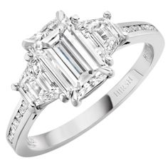 Part of the Trio collection of engagement rings from Hirsh. Emerald cut diamond with trapezoids, price on application.