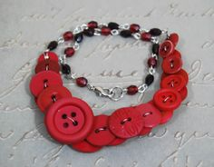 Asymmetric Necklace with Dark Red Buttons by CuriousJewelry