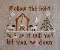 Winter Sampler by Cosmic Handmade stitched by Lynn Jon 32 ct naturel linen using DMC floss  Chart can be found here