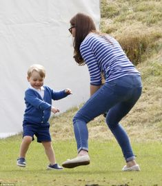 Kate is full of energy jumping from side to side, as she plays with a laughing George, who...