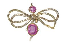 Gold pendant in the form of a bow: 16th-17th centuryGold pendant in the form of a bow set with fancy-cut and trap-cut foil-backed rubies and table-cut diamonds. The pendant, called a 'flower' in Elizabethan times, was often attached by a ribbon to the left breast. Pendants also adorned the hair and the neckline. Part of the Cheapside Hoard.