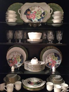 China cabinet display. Tobacco Leaf with Herend Golden Edge and Anna Weatherly chargers.