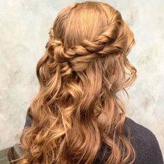 Double half up twisted and pinned into loose curls