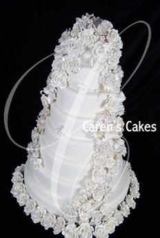 Kansas City Wedding Cakes by Caren's Cakes. Rolled fondant with handmade gumpaste flowers (sugar flowers) Photo By: Flashes Photography